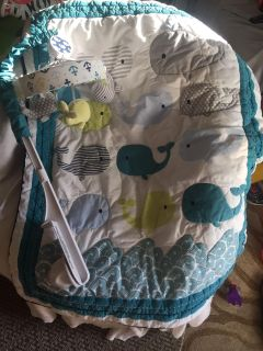 Whale mobile and crib blanket