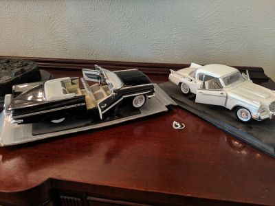 Lot of 2 model cars. Great condition. Steering wheel broken in white car.