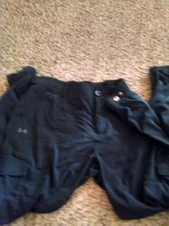 Under Armour black light weight joggers... Has cargo pockets... Euc!! Size Large... Elastic ankles