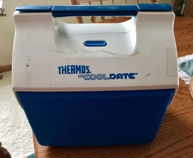 Thermos cooldate plastic cooler. Needs to be cleaned up. Been sitting in garage