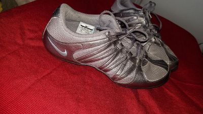 Silver and Turquoise Nike running shoes