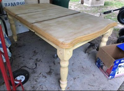 Wooden table with leaf extension