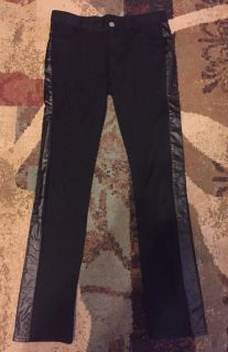 Girls size 10-12 black pants with leather look down sides. Excellent shape $5