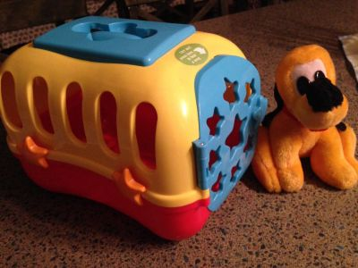 Musical toy puppy carrier
