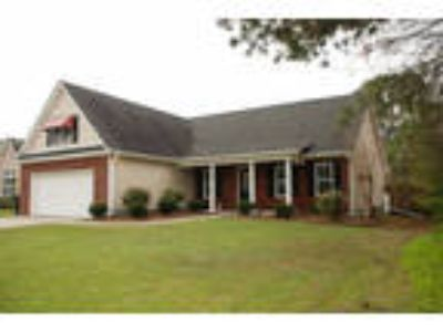 Low country style open floor plan home nestled on quite street