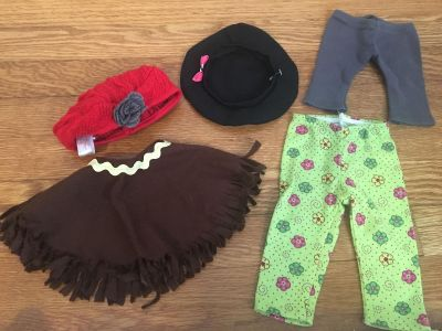 Assorted 18 American girl doll sized clothes (2 pants, poncho and 2 hats) GUC $5 for all!