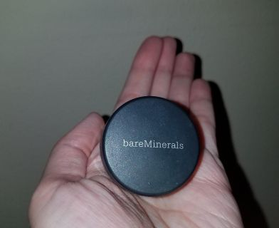 """bareMinerals all over face color in """"faux tan"""". This is a bronzing powder."""