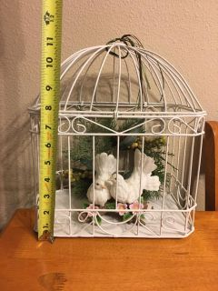 $20 OBO cut cage with birds in it