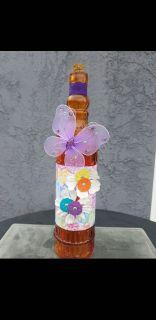 Spring surprise repurposed wine bottle