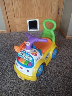 Fisher price little people music parade ride-on