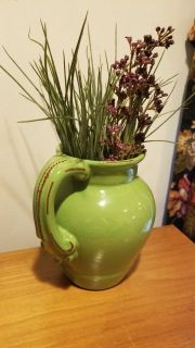 Pitcher with faux flowers