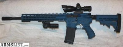 "For Sale: Stag Arms Blue Cerakote Left Hand AR-15 Rifle, 16"" Chrome Lined Barrel, Caliber 223/5.56, Aluminum Lower, Tactical Slim Keymod Handguard, Vertical Folding Grip, LH Safety, SS Trigger & Hammer, 2.5-10X Dual Illuminated Tactical Scope With Red Laser, 30 Rou"