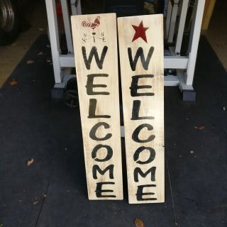 2 left welcome signs on solid wood