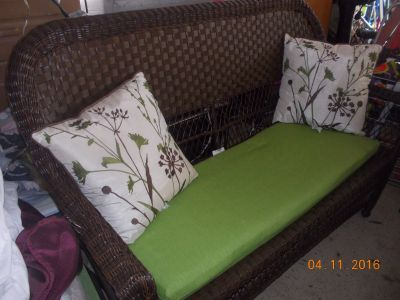 rattan/wicker patio couch and chair w/pillows