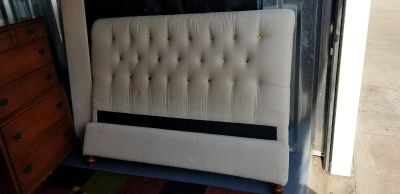 beige upholstered queen size sleigh bed