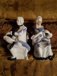 MALE AND FEMALE COLONIAL FIGURINES