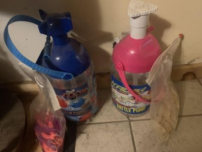 Good used condition water balloon battle pumps with balloons