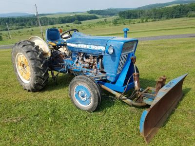 69 ford 3000 dozer, tire chains, wheel weights front and back