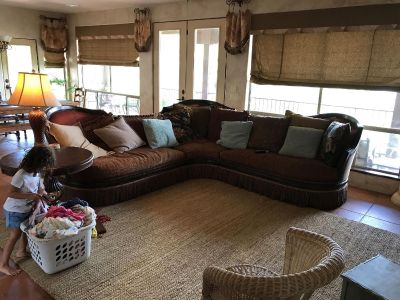 Unique old world style couch and potty barn rug