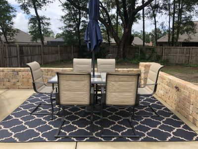 Outdoor patio set (less than 3 months old) EXCELLENT condition. Price includes table, 6 chairs, umbrella and stand.