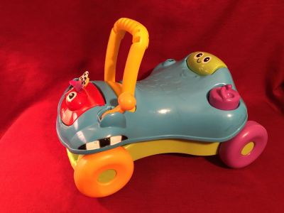 Playskool Step n Ride Opens to Push Walker (Photo Attached). Good Condition