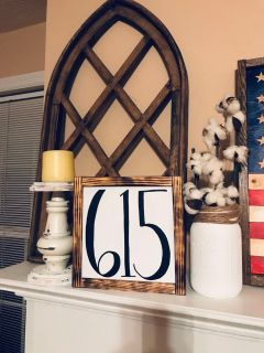 Area code wooden sign with torched frame