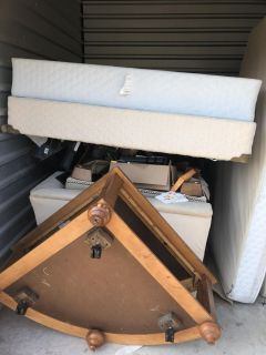 Storage with chair and ottoman and table and mattress