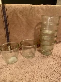 7 large candle holders/jars