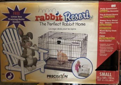 Rabbit cage and 2 bags of bedding! W