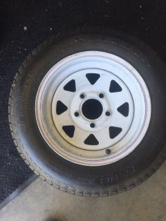 Trailer tire and wheel. 13 . Great tread. Almost new.