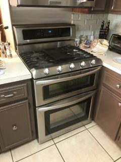 Gas stainless steel, 5 burner range, double oven and microwave combo