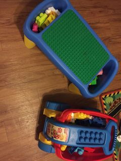 Little LEGO table and wagon full of legos in great condition both for $25