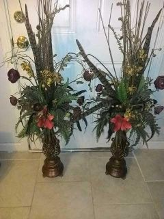 Flowers,ferns and feathers in a pair of lovely bronze vases