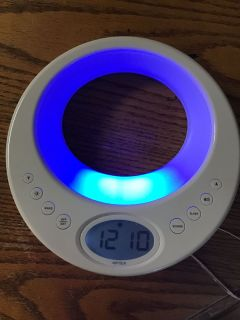 Verilux alarm clock/ radio and sleep system with color changing led light