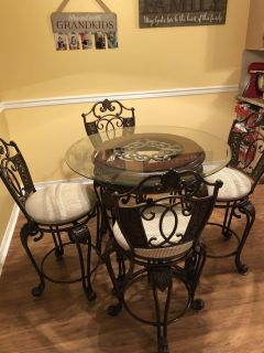 Pretty high top glass dining table with 4 chairs