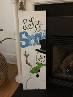 Hand crafted let it snow sign.
