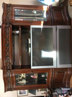 TV cabinet with glass display shelving TV included