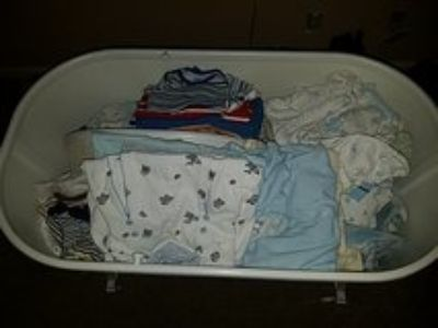 bassinet full of boy 0 to 6 month baby clothes