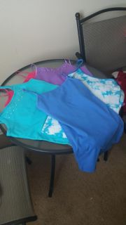 5 girls tank tops in excellent condition. Fit size 10 12 girls