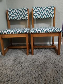 Two wooden blue accent chairs