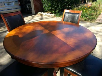 Wood table with 4 chairs.