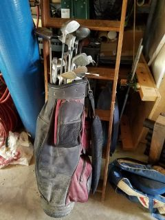 Complete set of golf clubs,bag,roughly 1000 used golf balls