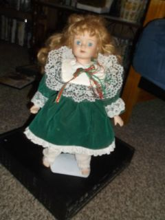 pretty blonde blue eyed proclein doll with stand