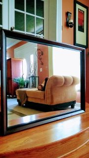 Huge and heavy solid wood framed wall mirror.