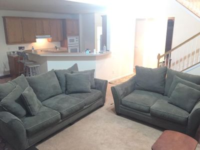 Forest green microfiber couch and loveseat
