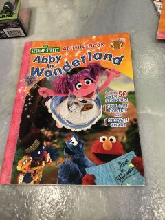 Brand new Sesame Street - Abby in Wonderland Activity Book with stickers, poster, and growth chart