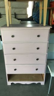 Real wood chest of drawers someone made a shell out of the bottom drawer