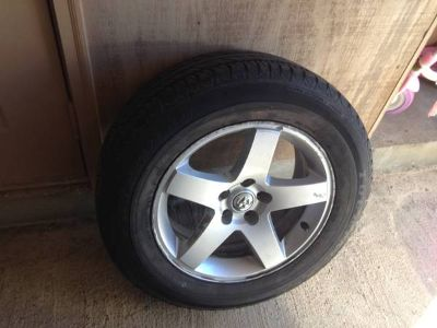 Tire and rim 22565R17