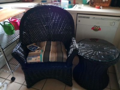 Wicker chair with glass top table and cushion