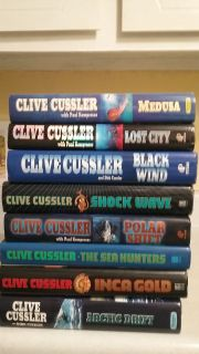 Eight Clive Cusssler Hardcover Books
